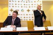 4 August 2004; Fran Rooney, Chief Executive Officer, Football Association of Ireland, left, and David Chick, Chairman, Senior Clubs Committee, Irish Football Association, take their seats for a press conference where the FAI and IFA formally launched an All Ireland Club Tournament. Fitzwilliam Hotel, St Stephens Green, Dublin. Picture credit; Ray McManus / SPORTSFILE