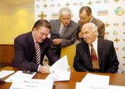 4 August 2004; Fran Rooney, left, Chief Executive Officer, Football Association of Ireland, Milo Corcoran, President, Football Association of Ireland, Niall Cogley, Chief Executive, Setanta Sports, and David Chick, right, Chairman, Senior Clubs Committee, Irish Football Association, at a press conference where the FAI and IFA formally launched an All Ireland Club Tournament. Fitzwilliam Hotel, St Stephens Green, Dublin. Picture credit; Ray McManus / SPORTSFILE