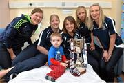16 September 2013; Galway senior and intermediate camogie stars, from left, Sinéad Keane, Roisin Callanan, Colette Gill, Niamh and Orla Kilkenny with Cia Roberts, age 2, from Chapelizod, Dublin, and the Jack McGrath Cup on a visit by the All-Ireland Senior & Intermediate Camogie Champions to Our Lady's Children's Hospital, Crumlin. Picture credit: Stephen McCarthy / SPORTSFILE