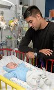 18 September 2013; Munster and Ireland Rugby star Conor Murray made a special visit to Temple Street Children's University Hospital, as part of Temple Street's 'Kiss Them Better' campaign. On the visit to the hospital Conor urged Irish families to buy Medicare plasters to support Temple Street. For every pack of Medicare plasters bought from pharmacies throughout the country, the Limerick based first-aid company will make a donation to the hospital's emergency equipment fund. Check out www.kissthembetter.ie for more information. Pictured with Conor Murray during the visit is 4-week-old Ruben Clifford, from Swords, Co. Dublin. Temple Street Children's University Hospital, Temple Street, Dublin. Picture credit: Stephen McCarthy / SPORTSFILE