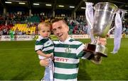 21 September 2013; Gary McCabe, Shamrock Rovers, celebrates with his 1 year old son Dylan after the game. EA Sports Cup Final, Shamrock Rovers v Drogheda United, Tallaght Stadium, Tallaght, Co. Dublin. Picture credit: Paul Mohan / SPORTSFILE
