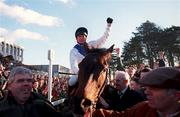 2 February 1997; Tommy Treacy celebrates on Danoli after winning The Champion Hurdle during Horse Racing from Leopardstown in Dublin. Photo by Brendan Moran/Sportsfile