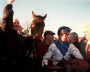 2 February 1997; Trainer Tom Foley, left, and jockey Tommy Treacy celebrate with Danoli after winning The Champion Hurdle during Horse Racing from Leopardstown in Dublin. Photo by Brendan Moran/Sportsfile