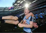 22 September 2013; Dublin's Paddy Andrews celebrates with team-mate Michael Darragh MacAuley after the match. GAA Football All-Ireland Senior Championship Final, Dublin v Mayo, Croke Park, Dublin. Picture credit: Brian Lawless / SPORTSFILE