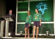 25 August 2004; Models Katy French, left, and Karen Fitzpatrick show off the new replica kit under the watchful eye of Fran Rooney, CEO, FAI, at the launch of the Association's new logo, website, fans club and range of merchandise in Jury's Hotel, Dublin. Picture credit; Ray McManus / SPORTSFILE
