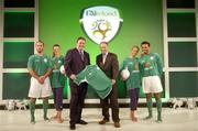 25 August 2004; Fran Rooney, CEO, FAI, with Republic of Ireland manager Brian Kerr and models, from left, Justin Manville, Karen Fitzpatrick, Katy French and Emy Onyesoh, at the launch of the Association's new logo, website, fans club and range of merchandise in Jury's Hotel, Dublin. Picture credit; Ray McManus / SPORTSFILE