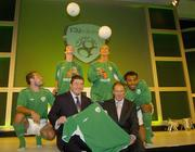 25 August 2004; Fran Rooney, CEO, FAI, with Republic of Ireland manager Brian Kerr and models Justin Manville, Karen Fitzpatrick, Katy French and Emy Onyesoh, at the launch of the Association's new logo, website, fans club and range of merchandise in Jury's Hotel, Dublin. Picture credit; Ray McManus / SPORTSFILE