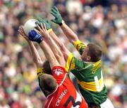 29 August 2004; Mike Frank Russell and Dara O'Cinneide,14, Kerry, in action against Niall McCuskey, Derry. Bank of Ireland Senior Football Championship Semi-Final, Derry v Kerry, Croke Park, Dublin. Picture credit; Matt Browne / SPORTSFILE