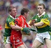 29 August 2004; Gavin Donaghy, Derry, is tackled by Dara O Cinneide, left, and Paddy Kelly, Kerry. Bank of Ireland Senior Football Championship Semi-Final, Derry v Kerry, Croke Park, Dublin. Picture credit; Ray McManus / SPORTSFILE