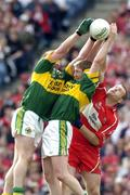 29 August 2004; Niall Mc Cusker, Derry, in action against Colm Cooper and Dara O Cinneide, Kerry. Bank of Ireland Senior Football Championship Semi-Final, Derry v Kerry, Croke Park, Dublin. Picture credit; Ray McManus / SPORTSFILE