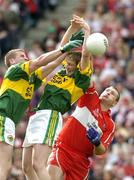 29 August 2004; Niall McCusker, Derry, in action against Dara O'Cinneide, left, and Mike Frank Russell, Kerry. Bank of Ireland Senior Football Championship Semi-Final, Derry v Kerry, Croke Park, Dublin. Picture credit; Ray McManus / SPORTSFILE