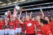29 September 2013; Cork manager Eamonn Ryan and the team celebrate with the Brendan Martin cup after the game. TG4 All-Ireland Ladies Football Senior Championship Final, Cork v Monaghan, Croke Park, Dublin. Picture credit: Ray McManus / SPORTSFILE