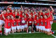 29 September 2013; Cork players and manager Eamonn Ryan celebrate with the Brendan Martin cup after the game. TG4 All-Ireland Ladies Football Senior Championship Final, Cork v Monaghan, Croke Park, Dublin. Picture credit: Paul Mohan / SPORTSFILE