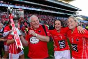 29 September 2013; Cork manager Eamonn Ryan, Geraldine O'Flynn and Angela Walsh, right, celebrate with the Brendan Martin cup after the game. TG4 All-Ireland Ladies Football Senior Championship Final, Cork v Monaghan, Croke Park, Dublin. Picture credit: Paul Mohan / SPORTSFILE