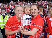 29 September 2013; Two year old Megan Walsh, from Killeagh, Co. Cork, with her godmother and Cork Captain Anne Marie Walsh, right, and Angela Walsh celebrate after the game. TG4 All-Ireland Ladies Football Senior Championship Final, Cork v Kerry, Croke Park, Dublin. Picture credit: Ray McManus / SPORTSFILE