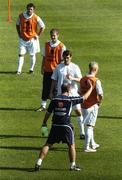 7 September 2004; Brian Kerr, Republic of Ireland manager, with players, from l to r; Andy Reid, Graham Barrett, Roy Keane and Graham Kavanagh, during squad training. St. Jakob Park, Basle, Switzerland. Picture credit; David Maher / SPORTSFILE