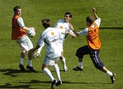 7 September 2004; Roy Keane, Republic of Ireland, in action  against team-mates, left to right,  Alan Quinn, Kevin Kilbane and Graham Barrett during squad training. St. Jakob Park, Basle, Switzerland. Picture credit; David Maher / SPORTSFILE
