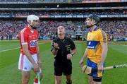 28 September 2013; Cork captain Patrick Cronin and Clare captain Patrick Donnellan look on as referee James McGrath tosses a commemorative Michael Collins coin before the GAA Hurling All-Ireland Senior Championship Final Replay match between Cork and Clare at Croke Park in Dublin. Photo by Ray McManus/Sportsfile