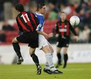 11 September 2004; Michael Collins, Athlone Town, in action against John Martin, Longford Town. FAI Cup Quarter-Final, Longford Town v Athlone Town, Flancare Park, Longford. Picture credit; David Maher / SPORTSFILE