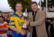 11 September 2004; Billy Finn, General Manager AIB Bank,  presents the cup to Portumna captain Ollie Canning. AIB Kilmacud Crokes All-Ireland Hurling Sevens 2004 Final, Portumna v Mullinahone, Kilmacud Crokes, Glenalbyn, Stillorgan, Dublin. Picture credit; Ray McManus / SPORTSFILE