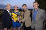 11 September 2004; Billy Finn, General Manager AIB Bank, second from right, presents the cup to Portumna captain Ollie Canning in the company of American Ambassador James J. Kenny, left, and Tom Rock, Chairman of the Kilmacud Crokes Sevens Organising Committee. AIB Kilmacud Crokes All-Ireland Hurling Sevens 2004 Final, Portumna v Mullinahone, Kilmacud Crokes, Glenalbyn, Stillorgan, Dublin. Picture credit; Ray McManus / SPORTSFILE
