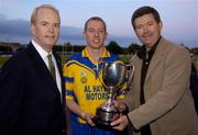 11 September 2004; Billy Finn, General Manager AIB Bank, right, presents the cup to Portumna captain Ollie Canning in the company of American Ambassador James J. Kenny, left. AIB Kilmacud Crokes All-Ireland Hurling Sevens 2004 Final, Portumna v Mullinahone, Kilmacud Crokes, Glenalbyn, Stillorgan, Dublin. Picture credit; Ray McManus / SPORTSFILE