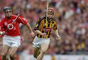 12 September 2004; Tommy Walsh, Kilkenny, in action against Ben O'Connor, Cork. Guinness All-Ireland Senior Hurling Championship Final, Cork v Kilkenny, Croke Park, Dublin. Picture credit; Ray McManus / SPORTSFILE *** Local Caption *** Any photograph taken by SPORTSFILE during, or in connection with, the 2004 Guinness All-Ireland Hurling Final which displays GAA logos or contains an image or part of an image of any GAA intellectual property, or, which contains images of a GAA player/players in their playing uniforms, may only be used for editorial and non-advertising purposes.  Use of photographs for advertising, as posters or for purchase separately is strictly prohibited unless prior written approval has been obtained from the Gaelic Athletic Association.