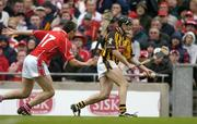 12 September 2004; Eddie Brennan, Kilkenny, in action against John Browne, Cork. Guinness All-Ireland Senior Hurling Championship Final, Cork v Kilkenny, Croke Park, Dublin. Picture credit; Ray McManus / SPORTSFILE *** Local Caption *** Any photograph taken by SPORTSFILE during, or in connection with, the 2004 Guinness All-Ireland Hurling Final which displays GAA logos or contains an image or part of an image of any GAA intellectual property, or, which contains images of a GAA player/players in their playing uniforms, may only be used for editorial and non-advertising purposes.  Use of photographs for advertising, as posters or for purchase separately is strictly prohibited unless prior written approval has been obtained from the Gaelic Athletic Association.