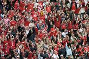 12 September 2004; Cork fans cheer on their side during the game. Guinness All-Ireland Senior Hurling Championship Final, Cork v Kilkenny, Croke Park, Dublin. Picture credit; Ray McManus / SPORTSFILE *** Local Caption *** Any photograph taken by SPORTSFILE during, or in connection with, the 2004 Guinness All-Ireland Hurling Final which displays GAA logos or contains an image or part of an image of any GAA intellectual property, or, which contains images of a GAA player/players in their playing uniforms, may only be used for editorial and non-advertising purposes.  Use of photographs for advertising, as posters or for purchase separately is strictly prohibited unless prior written approval has been obtained from the Gaelic Athletic Association.
