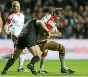 4 October 2013; Chris Henry, Ulster, is tackled by Duncan Jones, Ospreys. Celtic League 2013/14, Round 5, Ospreys v Ulster, Liberty Stadium, Swansea, Wales. Picture credit: Steve Pope / SPORTSFILE