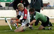 18 September 2004; Tommy Bowe, Ulster, holds off the challenge from Conor McPhillips, Connacht, to score his a try for his side. Celtic League 2004-2005, Connacht v Ulster, Sportsground, Galway. Picture credit; David Maher / SPORTSFILE