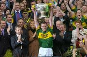 26 September 2004; Kerry captain Dara O Cinneide lifts the Sam Maguire Cup. Bank of Ireland All-Ireland Senior Football Championship Final, Kerry v Mayo, Croke Park, Dublin. Picture credit; Ray McManus / SPORTSFILE *** Local Caption *** Any photograph taken by SPORTSFILE during, or in connection with, the 2004 Bank of Ireland All-Ireland Senior Football Final which displays GAA logos or contains an image or part of an image of any GAA intellectual property, or, which contains images of a GAA player/players in their playing uniforms, may only be used for editorial and non-advertising purposes.  Use of photographs for advertising, as posters or for purchase separately is strictly prohibited unless prior written approval has been obtained from the Gaelic Athletic Association.