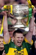 26 September 2004; Kerry captain Dara O'Cinneide lifts the Sam Maguire Cup. Bank of Ireland All-Ireland Senior Football Championship Final, Kerry v Mayo, Croke Park, Dublin. Picture credit; Damien Eagers / SPORTSFILE *** Local Caption *** Any photograph taken by SPORTSFILE during, or in connection with, the 2004 Bank of Ireland All-Ireland Senior Football Final which displays GAA logos or contains an image or part of an image of any GAA intellectual property, or, which contains images of a GAA player/players in their playing uniforms, may only be used for editorial and non-advertising purposes.  Use of photographs for advertising, as posters or for purchase separately is strictly prohibited unless prior written approval has been obtained from the Gaelic Athletic Association.