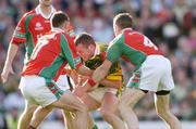 26 September 2004; Dara O Cinneide, Kerry, in action against Pat Kelly, 7, and Gary Ruane, Mayo. Bank of Ireland All-Ireland Senior Football Championship Final, Kerry v Mayo, Croke Park, Dublin. Picture credit; Ray McManus / SPORTSFILE *** Local Caption *** Any photograph taken by SPORTSFILE during, or in connection with, the 2004 Bank of Ireland All-Ireland Senior Football Final which displays GAA logos or contains an image or part of an image of any GAA intellectual property, or, which contains images of a GAA player/players in their playing uniforms, may only be used for editorial and non-advertising purposes.  Use of photographs for advertising, as posters or for purchase separately is strictly prohibited unless prior written approval has been obtained from the Gaelic Athletic Association.