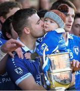 13 October 2013; Paddy Dowdall, St Lomans, celebrates with his son Shea Dowdall after victory over Tyrrellspass. Westmeath County Senior Club Football Championship Final, St Lomans v Tyrrellspass, Cusack Park, Mullingar, Co Westmeath. Picture credit: Ramsey Cardy / SPORTSFILE