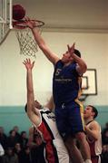 17 January 1999; Chris Doyal of St Vincent's attempts a lay up despite the attentions of John Leahy of Star of the Sea during the ESB Men's Superleague basketball match between St Vincent's and Star of The Sea at St Vincent's Basketball Club in Glasnevin, Dublin. Photo By Brendan Moran/Sportsfile.