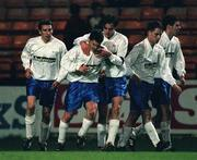 27 November 1998; Ciaran Kavanagh of UCD, second from left, is congratulated by team-mates after scoring his sides first goal during the  Harp Lager National League Premier Division match between Shelbourne and UCD at Tolka Park in Dublin. Photo by Aoife Rice/Sportsfile.