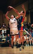 Meteors' Gillian Morris has her shot blocked by Wildcats' Jillian Hayes in the Sprite Cup semi-final on Saturday evening in the National Basketball Arena in Tallaght, Dublin. 24/1/98. Photograph Brendan Moran SPORTSFILE