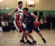 17 January 1999; Karl Donnelly of St Vincent's in action against Gary O'Neill of Star of The Sea during the ESB Men's Superleague basketball match between St Vincent's and Star of The Sea at St Vincent's Basketball Club in Glasnevin, Dublin. Photo By Brendan Moran/Sportsfile.