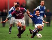 13 January 1999: Tony Izzy, Cobh Ramblers  is tackled by Declan Schutte, Garda A.F.C.. Garda A.F.C. v Cobh Ramblers, Harp Lager Senior Challenge Cup, Westmanstown. Picture credit: Matt Browne/SPORTSFILE