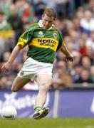 26 September 2004; Dara O Cinneide, Kerry, kicks a free against Mayo. Bank of Ireland All-Ireland Senior Football Championship Final, Kerry v Mayo, Croke Park, Dublin. Picture credit; Brendan Moran / SPORTSFILE *** Local Caption *** Any photograph taken by SPORTSFILE during, or in connection with, the 2004 Bank of Ireland All-Ireland Senior Football Final which displays GAA logos or contains an image or part of an image of any GAA intellectual property, or, which contains images of a GAA player/players in their playing uniforms, may only be used for editorial and non-advertising purposes.  Use of photographs for advertising, as posters or for purchase separately is strictly prohibited unless prior written approval has been obtained from the Gaelic Athletic Association.