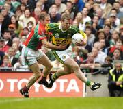 26 September 2004; Dara O Cinneide, Kerry, in action against Gary Ruane, Mayo. Bank of Ireland All-Ireland Senior Football Championship Final, Kerry v Mayo, Croke Park, Dublin. Picture credit; Brendan Moran / SPORTSFILE *** Local Caption *** Any photograph taken by SPORTSFILE during, or in connection with, the 2004 Bank of Ireland All-Ireland Senior Football Final which displays GAA logos or contains an image or part of an image of any GAA intellectual property, or, which contains images of a GAA player/players in their playing uniforms, may only be used for editorial and non-advertising purposes.  Use of photographs for advertising, as posters or for purchase separately is strictly prohibited unless prior written approval has been obtained from the Gaelic Athletic Association.