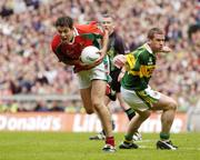 26 September 2004; Fergal Kelly, Mayo, in action against Dara O Cinneide, Kerry. Bank of Ireland All-Ireland Senior Football Championship Final, Kerry v Mayo, Croke Park, Dublin. Picture credit; Brendan Moran / SPORTSFILE *** Local Caption *** Any photograph taken by SPORTSFILE during, or in connection with, the 2004 Bank of Ireland All-Ireland Senior Football Final which displays GAA logos or contains an image or part of an image of any GAA intellectual property, or, which contains images of a GAA player/players in their playing uniforms, may only be used for editorial and non-advertising purposes.  Use of photographs for advertising, as posters or for purchase separately is strictly prohibited unless prior written approval has been obtained from the Gaelic Athletic Association.