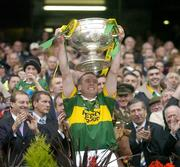 26 September 2004; Kerry captain Dara O Cinneide lifts the Sam Maguire cup after victory over Mayo. Bank of Ireland All-Ireland Senior Football Championship Final, Kerry v Mayo, Croke Park, Dublin. Picture credit; Brendan Moran / SPORTSFILE *** Local Caption *** Any photograph taken by SPORTSFILE during, or in connection with, the 2004 Bank of Ireland All-Ireland Senior Football Final which displays GAA logos or contains an image or part of an image of any GAA intellectual property, or, which contains images of a GAA player/players in their playing uniforms, may only be used for editorial and non-advertising purposes.  Use of photographs for advertising, as posters or for purchase separately is strictly prohibited unless prior written approval has been obtained from the Gaelic Athletic Association.