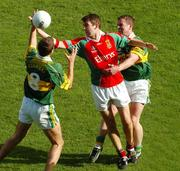 26 September 2004; Ronan McGarrity, Mayo, in action against Kerry's Eoin Brosnan, 8, and Dara O Cinneide. Bank of Ireland All-Ireland Senior Football Championship Final, Kerry v Mayo, Croke Park, Dublin. Picture credit; Pat Murphy / SPORTSFILE *** Local Caption *** Any photograph taken by SPORTSFILE during, or in connection with, the 2004 Bank of Ireland All-Ireland Senior Football Final which displays GAA logos or contains an image or part of an image of any GAA intellectual property, or, which contains images of a GAA player/players in their playing uniforms, may only be used for editorial and non-advertising purposes.  Use of photographs for advertising, as posters or for purchase separately is strictly prohibited unless prior written approval has been obtained from the Gaelic Athletic Association.