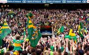 26 September 2004; Kerry fans celebrate as captain Dara O Cinneide prepares to lift the Sam Maguire cup. Bank of Ireland All-Ireland Senior Football Championship Final, Kerry v Mayo, Croke Park, Dublin. Picture credit; Ray McManus / SPORTSFILE *** Local Caption *** Any photograph taken by SPORTSFILE during, or in connection with, the 2004 Bank of Ireland All-Ireland Senior Football Final which displays GAA logos or contains an image or part of an image of any GAA intellectual property, or, which contains images of a GAA player/players in their playing uniforms, may only be used for editorial and non-advertising purposes.  Use of photographs for advertising, as posters or for purchase separately is strictly prohibited unless prior written approval has been obtained from the Gaelic Athletic Association.