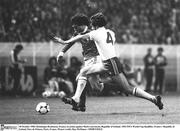 28 October 1980; Dominique Rocheteau, France, in action against Mark Lawrenson, Republic of Ireland. 1982 FIFA World Cup Qualifier, France v Republic of Ireland, Parc de Princes, Paris, France. Picture credit; Ray McManus / SPORTSFILE