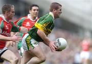 26 September 2004; Dara O'Cinneide, Kerry, in action against Gary Ruane, Mayo. Bank of Ireland All-Ireland Senior Football Championship Final, Kerry v Mayo, Croke Park, Dublin. Picture credit; Brian Lawless / SPORTSFILE *** Local Caption *** Any photograph taken by SPORTSFILE during, or in connection with, the 2004 Bank of Ireland All-Ireland Senior Football Final which displays GAA logos or contains an image or part of an image of any GAA intellectual property, or, which contains images of a GAA player/players in their playing uniforms, may only be used for editorial and non-advertising purposes.  Use of photographs for advertising, as posters or for purchase separately is strictly prohibited unless prior written approval has been obtained from the Gaelic Athletic Association.