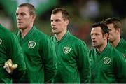 15 October 2013; Republic of Ireland's Richard Dunne, right, Darron Gibson and Andy Reid, left, during the National Anthem. 2014 FIFA World Cup Qualifier, Group C, Republic of Ireland v Kazakhstan, Aviva Stadium, Lansdowne Road, Dublin. Picture credit: Brendan Moran / SPORTSFILE