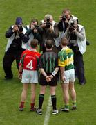 26 September 2004; Mayo captain Gary Ruane and Kerry captain Dara O Cinneide stand for a picture with referee Pat McEnaney before the game. Bank of Ireland All-Ireland Senior Football Championship Final, Kerry v Mayo, Croke Park, Dublin. Picture credit; Pat Murphy / SPORTSFILE *** Local Caption *** Any photograph taken by SPORTSFILE during, or in connection with, the 2004 Bank of Ireland All-Ireland Senior Football Final which displays GAA logos or contains an image or part of an image of any GAA intellectual property, or, which contains images of a GAA player/players in their playing uniforms, may only be used for editorial and non-advertising purposes.  Use of photographs for advertising, as posters or for purchase separately is strictly prohibited unless prior written approval has been obtained from the Gaelic Athletic Association.